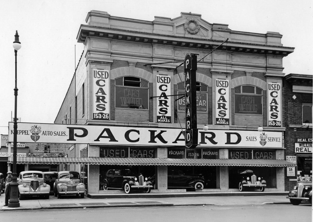 Koeppel Auto Sales, a Packard and used car dealership. Jamaica, Long Island, New York; photo circa 1940.